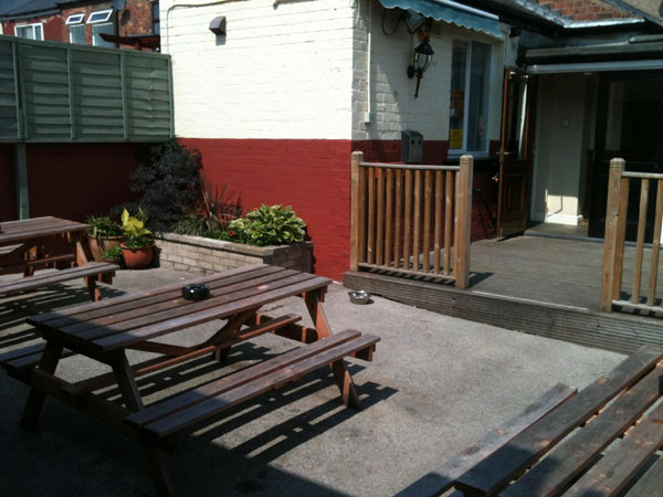 Our lovely suntrap of a beer garden!
